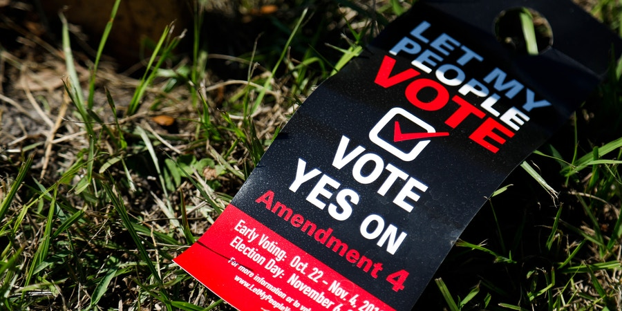 A flier for Amendment 4 is seen in Orlando on Monday, October 29, 2018. In the upcoming election on November 6, Floridians will have the opportunity to vote on Amendment 4, which would give people who have been convicted of a felony the restored right to vote. Credit: Eve Edelheit for The Intercept