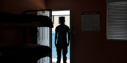 Honduran migrant minor, Javier, 17, is pictured in his room at