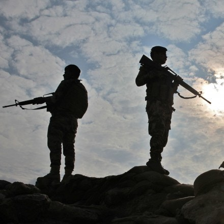 Iraqi soldiers stand guard near the Iraqi city of Qaim at the Iraqi-Syrian border on November 11, 2018. - Iraqi troops reinforced their positions along the porous frontier with neighbouring war-torn Syria, fearing a spillover from clashes there between Islamic State group and US-backed forces. (Photo by AHMAD AL-RUBAYE / AFP)        (Photo credit should read AHMAD AL-RUBAYE/AFP/Getty Images)
