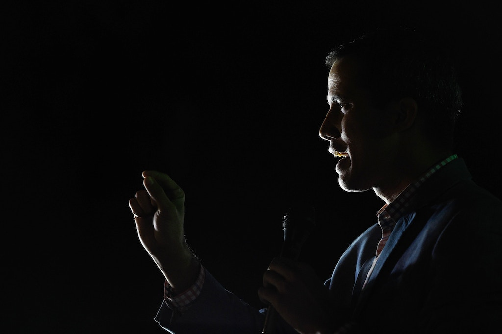 Venezuela's National Assembly president Juan Guaido gestures as he speaks before a crowd of opposition supporters during an open meeting in Caracas, on January 16, 2019. - A dozen intelligence service agents were sent to prison by a Venezuelan court Wednesday over the brief detention of parliamentary president Juan Guaido, a judicial source said. Guaido was heading to a political rally outside the Venezuelan capital on Sunday when his car was stopped on a highway and he was briefly detained by intelligence service agents. (Photo by Federico PARRA / AFP)        (Photo credit should read FEDERICO PARRA/AFP/Getty Images)