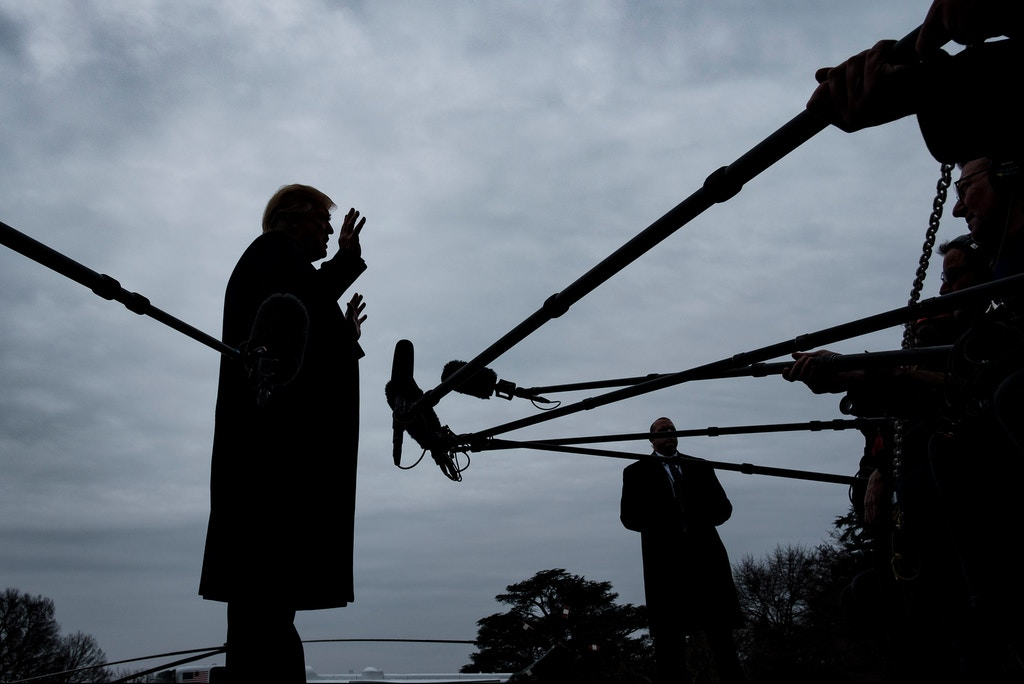 WASHINGTON, DC - JANUARY 19: U.S. President Donald Trump stops to speak to reporters as he prepared to board Marine One on the South Lawn of the White House on January 19, 2019 in Washington, DC. Trump is traveling to Dover Air Force Base in Delaware to visit with families four Americans who were killed in an explosion Wednesday in Syria. (Photo by Pete Marovich/Getty Images)