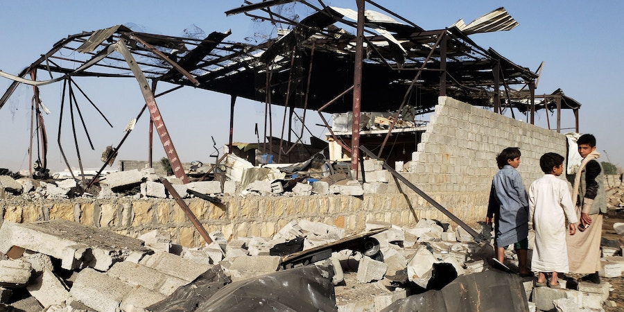 20 January 2019, Yemen, Sanaa: Yemeni children inspect the damage at a site allegedly targeted and destroyed by Saudi-led air strikes. Photo: Hani Al-Ansi/dpa (Photo by Hani Al-Ansi/picture alliance via Getty Images)