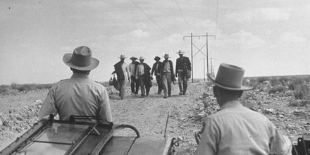 Border patrol waiting for illegal immigrants to reach their position.  (Photo by Loomis Dean/The LIFE Picture Collection/Getty Images)