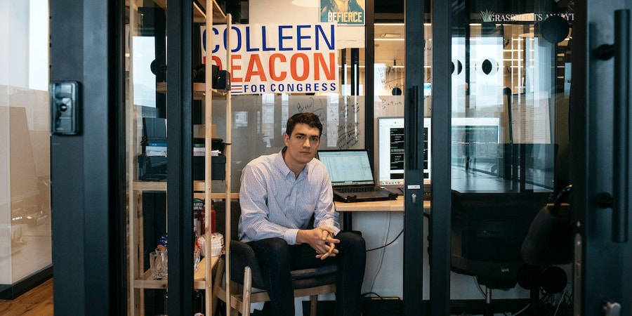 Danny Hogenkamp, founder of Grassroots Analytics, in his office in a co-working space in Washington D.C.