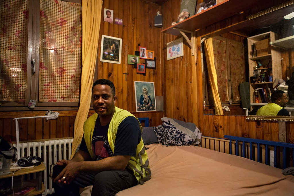 Laurent Lallane, wears a yellow to show solidarity with the Gilet Jaune protesters at his home in the Paris suburb of Bobigny, France, January 11, 2018. Lallane said that while he supports the Gilet Jaune movement, he doesn't protest because the police will more outwardly target black protesters. Joe Penney for The Intercept