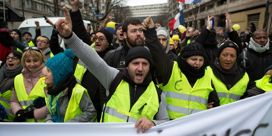 Gilet Jaune protesters chant slogans while marching in Paris, France, January 12, 2018. Joe Penney for The Intercept