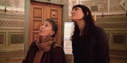 "Scholar Silvia Federici, left, and Astra Taylor discuss ""The Allegory of Good and Bad Government,"" a series of frescoes which is on display in the Palazzo Pubblico in Siena, Italy, in a scene from ""What Is Democracy?"""