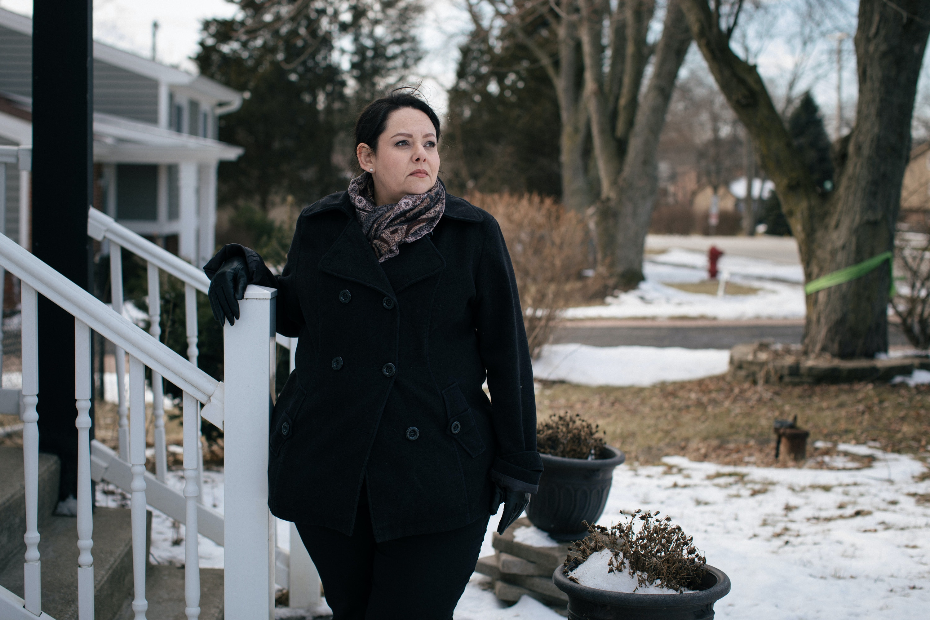 Willowbrook, Illinois -- Thursday, February 22, 2019. Gabriela Tejeda-Rios, an immigration lawyer, poses for a portrait outside of her home in Willowbrook. The home, which Tejeda-Rios moved to in 2009, is 0.2 miles from the Sterigenics plant that has been emitting a carcinogenic chemical called ethylene oxide.