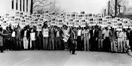 "Sanitation workers assemble in front of Clayborn Temple for a solidarity march carrying ""I Am A Man"" signs in Memphis, Tenn., in March 1968."