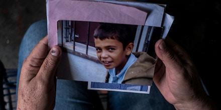 Amalia Díaz holds an old photo of her deceased grandson, Jorge Alexander Ruiz.