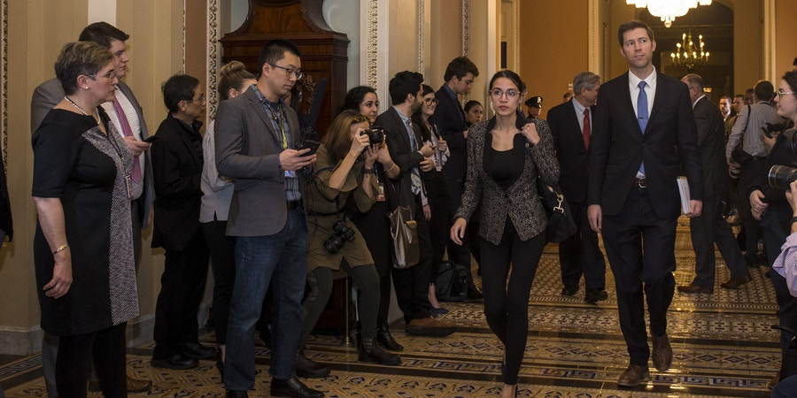 WASHINGTON, DC - JANUARY 24: Rep. Alexandria Ocasio-Cortez (D-NY) walks to the Senate Chamber on Capitol Hill, January 24, 2019 at the U.S. Capitol in Washington, DC. The Senate has failed to pass two procedural votes, one proposed by Republicans and the other proposed by the Democrats, to re-open the government.(Photo by Zach Gibson/Getty Images)