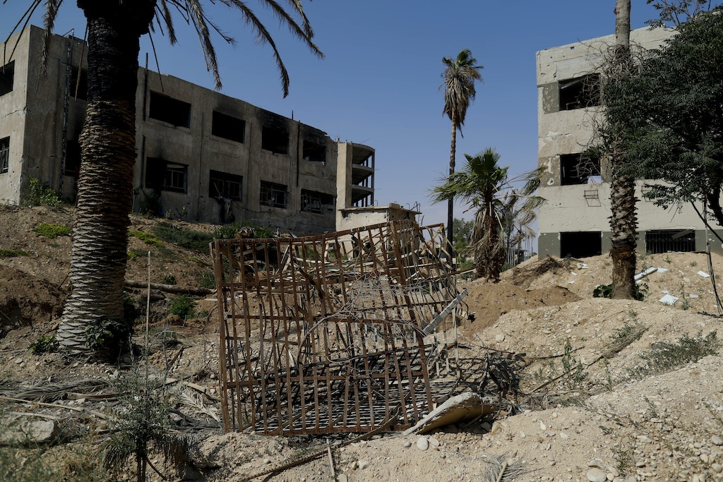 In this July 15, 2018 photo, a cage used by the Army of Islam for prisoners is abandoned Tawbeh Prison, in Douma, near the Syrian capital Damascus, Syria. The fate of activist Razan Zaitouneh is one of the longest-running mysteries of Syria's civil war. There's been no sign of life, no proof of death since gunmen abducted her and three of her colleagues from her offices in the rebel-held town of Douma in 2013. Now Douma is in government hands and clues have emerged that may bring answers. (AP Photo/Hassan Ammar)