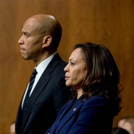 Sen. Cory Booker, D-N.J., and Sen. Kamala Harris, D-Calif., listen as Sen. Jeff Flake, R-Ariz., speaks during a Senate Judiciary Committee hearing on Supreme Court nominee Judge Brett Kavanaugh, Friday, Sept. 28, 2018, on Capitol Hill in Washington. The committee advanced Brett Kavanaugh's nomination for the Supreme Court after agreeing to a late call from Sen. Jeff Flake, R-Ariz., for a one week investigation into sexual assault allegations against the high court nominee. (AP Photo/Andrew Harnik)