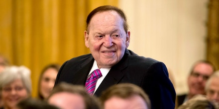 Las Vegas Sands Corporation Chief Executive and Republican mega donor Sheldon Adelson, stands as he is recognized by President Donald Trump during a Medal of Freedom ceremony in the East Room of the White House in Washington, Friday, Nov. 16, 2018. Adelson's wife Miriam Adelson received a Medal of Freedom. (AP Photo/Andrew Harnik)