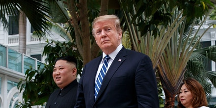 President Donald Trump and North Korean leader Kim Jong Un take a walk at the Sofitel Legend Metropole Hanoi hotel, Thursday, Feb. 28, 2019, in Hanoi. (AP Photo/ Evan Vucci)