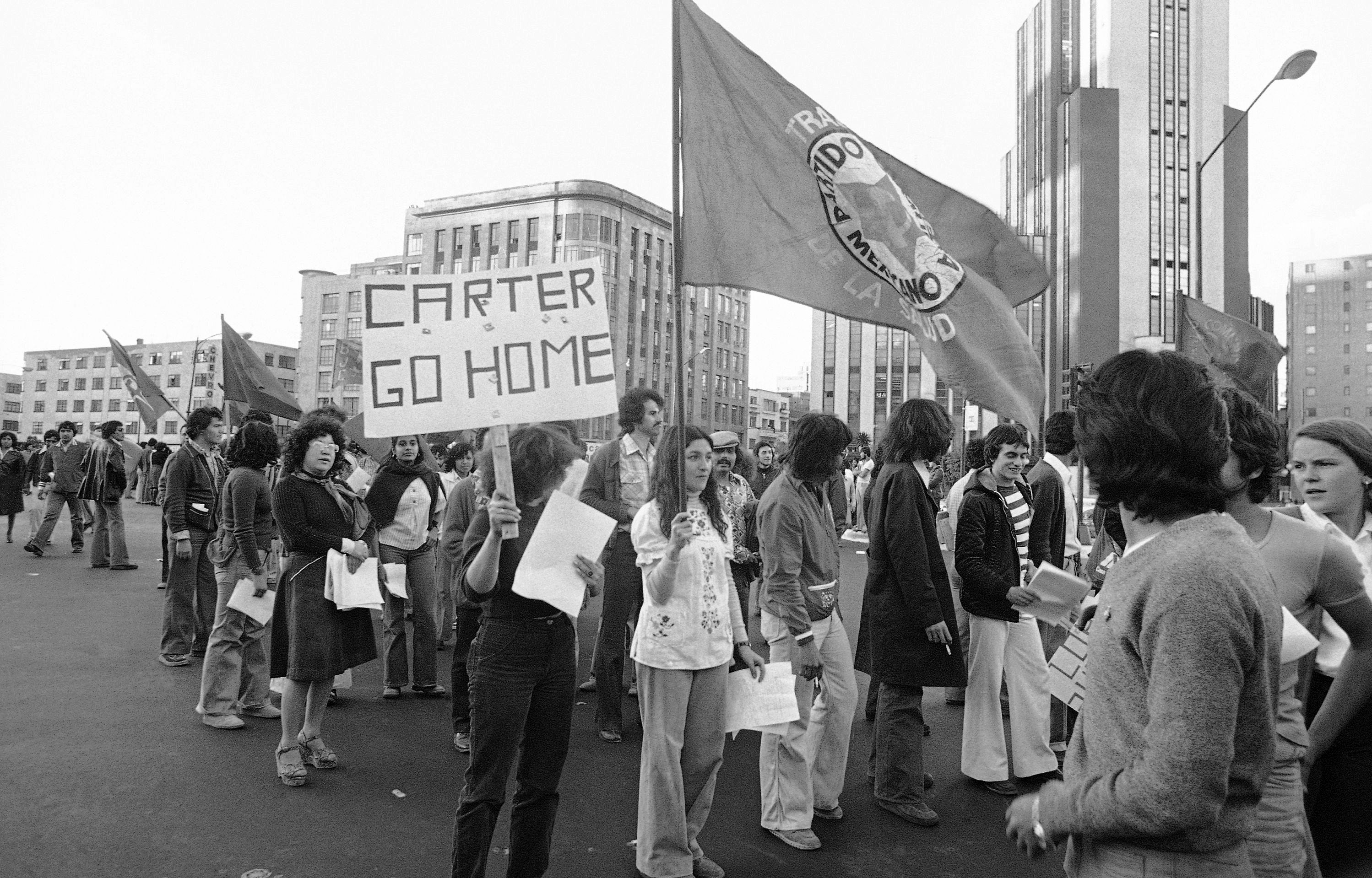 Members of Mexico?s Socialist Workers Party carry placard with anti-Carter slogan in Mexico City, Feb. 7, 1979. March was called by telephone workers protesting for higher wages, but they were joined by 15 to 20 other organizations which focused on Carter?s upcoming visit to Mexico Feb. 14 to 16. Police estimated 5,000 persons took part in the demonstration. (AP Photo/Valente Cotera)