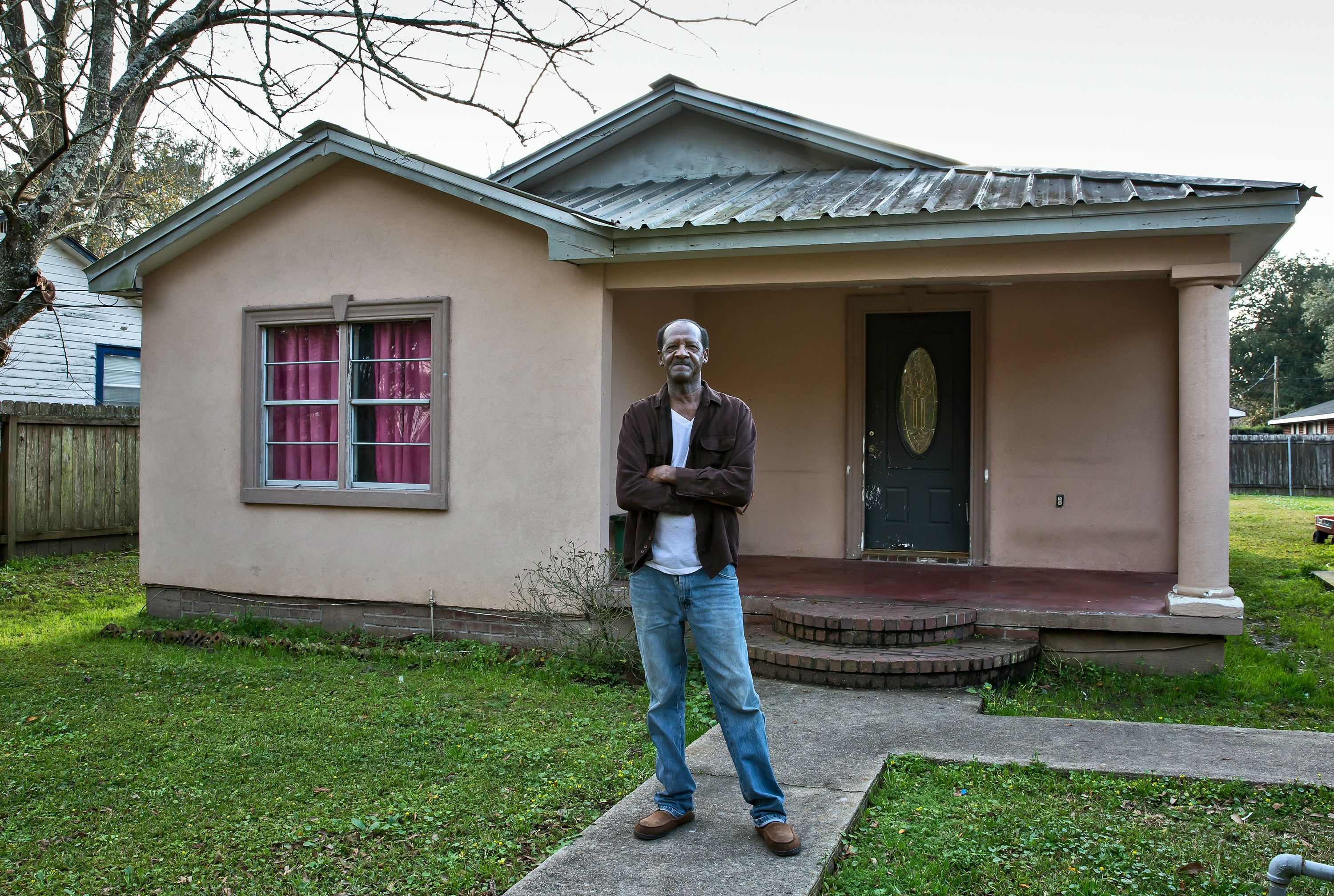 David Sanders in front of his home which is across the street from Denka/DuPont's fenceline .Feb. 6, 2019