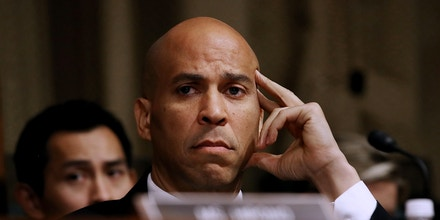 WASHINGTON, DC - SEPTEMBER 27:  Senate Judiciary Committee member Sen. Cory Booker (D-NJ) listens to opening statements before hearing from Christine Blasey Ford in the Senate Judiciary Committee in the Dirksen Senate Office Building on Capitol Hill September 27, 2018 in Washington, DC. A professor at Palo Alto University and a research psychologist at the Stanford University School of Medicine, Ford has accused Supreme Court nominee Judge Brett Kavanaugh of sexually assaulting her during a party in 1982 when they were high school students in suburban Maryland.  (Photo by Win McNamee/Getty Images)