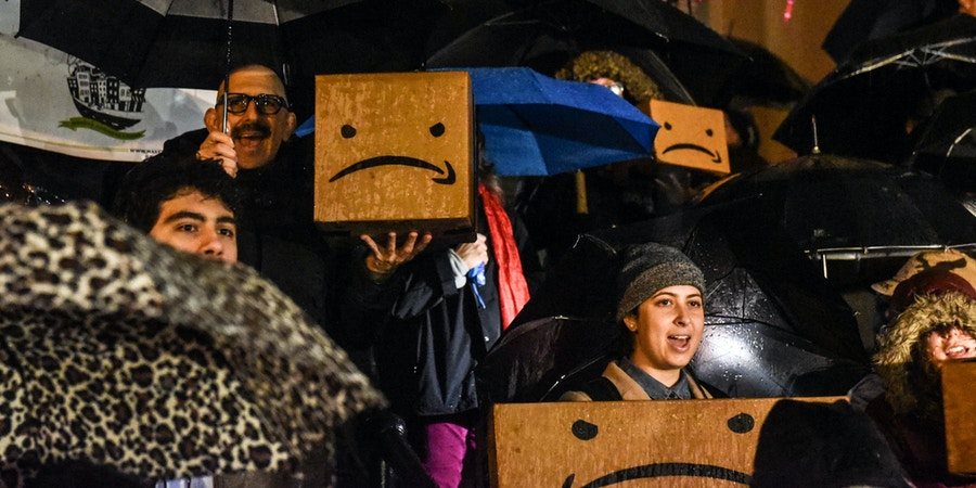 NEW YORK, NY - NOVEMBER 26: People opposed to Amazon's plan to locate a headquarters in New York City hold a protest in Court House Square on November 26, 2018 in the Long Island City neighborhood of the Queens borough of New York City. Amazon recently named Long Island City as one of two locations that will house Amazon's second North American headquarters, known as HQ2.  (Photo by Stephanie Keith/Getty Images)