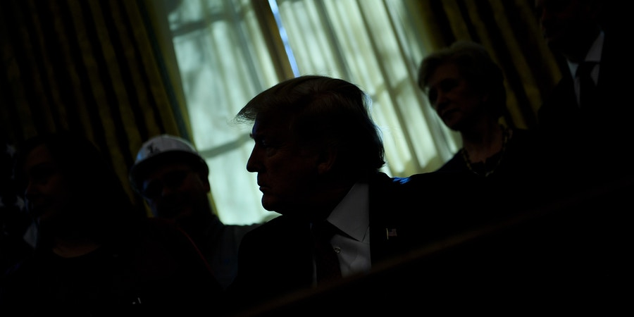 TOPSHOT - US President Donald Trump pauses while speaking during an executive order signing in the Oval Office of the White House January 31, 2019 in Washington, DC. - President Trump was signing an executive order pushing those who receive federal funds to
