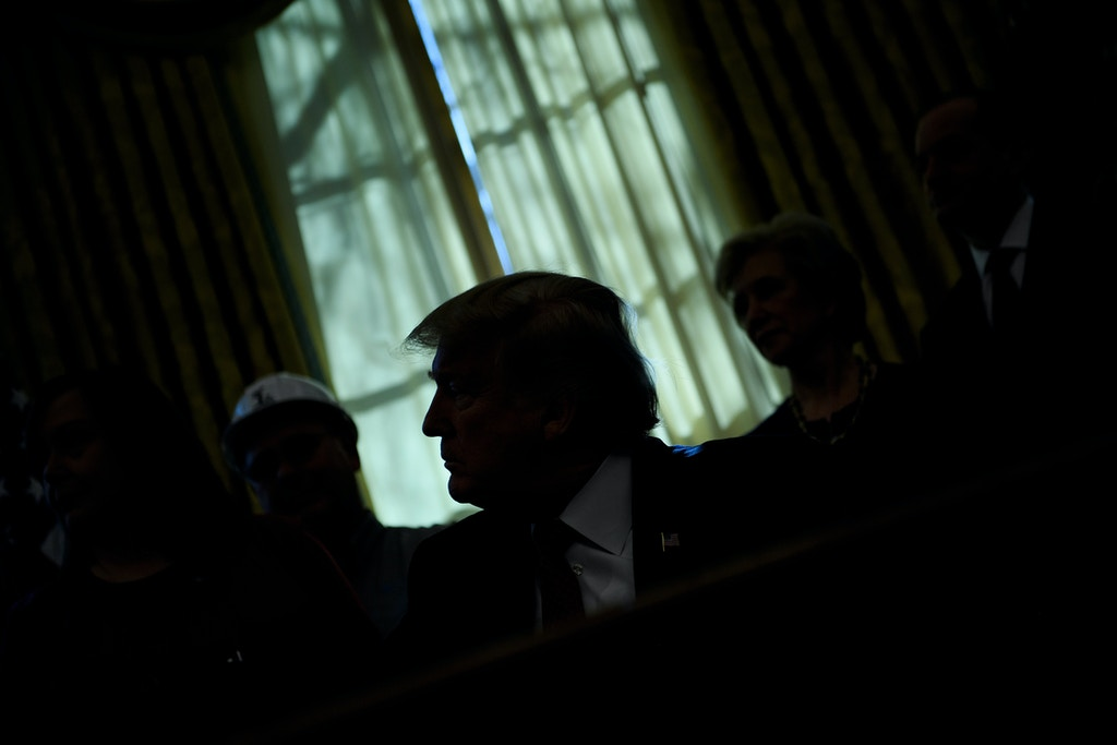 "TOPSHOT - US President Donald Trump pauses while speaking during an executive order signing in the Oval Office of the White House January 31, 2019 in Washington, DC. - President Trump was signing an executive order pushing those who receive federal funds to ""buy American."" (Photo by Brendan Smialowski / AFP)        (Photo credit should read BRENDAN SMIALOWSKI/AFP/Getty Images)"