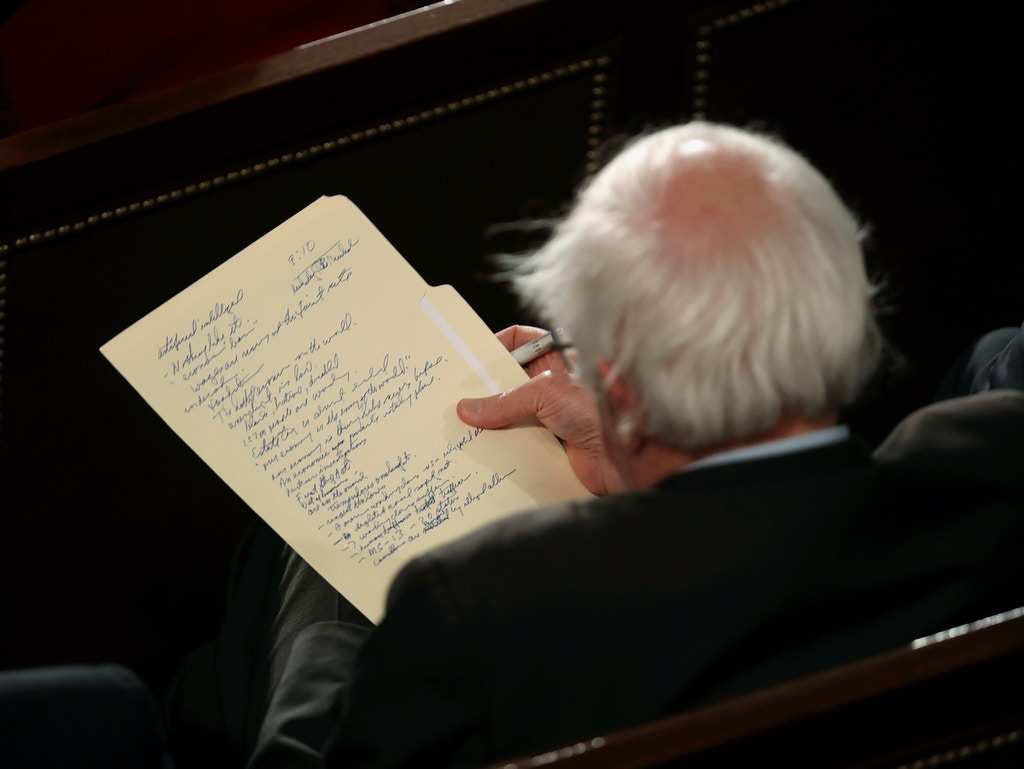WASHINGTON, DC - FEBRUARY 05:  Sen. Bernie Sanders (I-VT) looks at his notes as he watches the State of the Union address in the chamber of the U.S. House of Representatives at the U.S. Capitol Building on February 5, 2019 in Washington, DC. President Trump's second State of the Union address was postponed one week due to the partial government shutdown.  (Photo by Win McNamee/Getty Images)