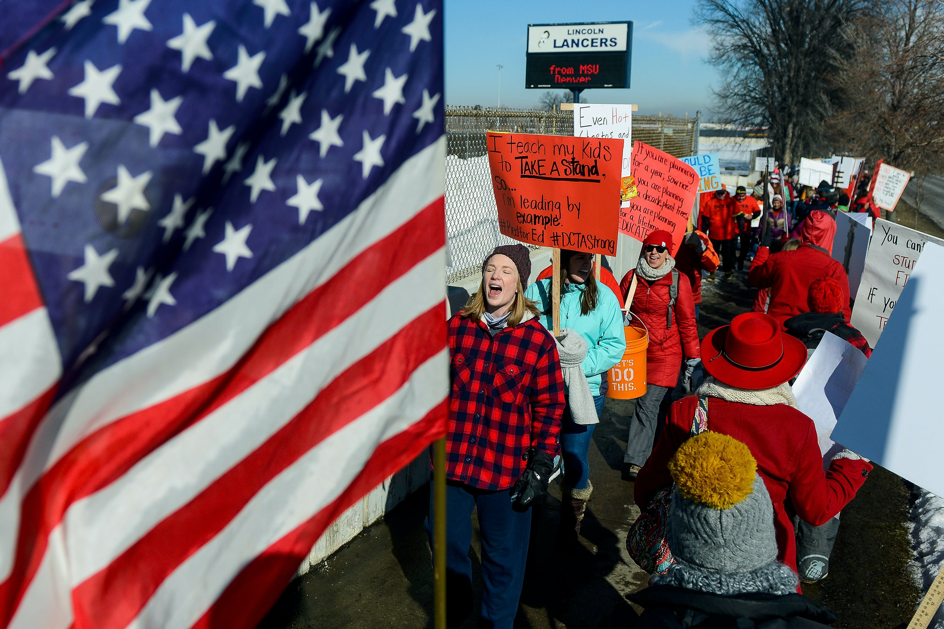 DENVER, CO - FEBRUARY 11: Denver teachers and community members picket outside Abraham Lincoln High School on February 11, 2019 in Denver, Colorado. Denver teachers are striking for the first time in 25 years after the school district and the union representing the educators failed to reach an agreement after 14 months of contract negations over teacher pay. (Photo by Michael Ciaglo/Getty Images)