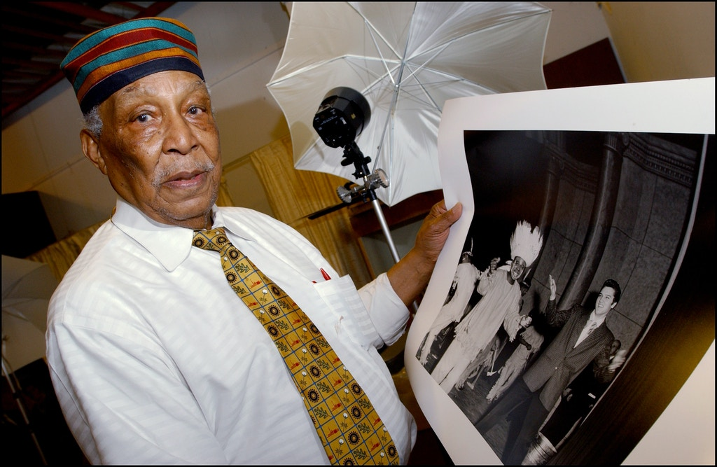 UNITED STATES - MAY 01:  Ernest C - Withers, 80 years old, is the most famous photographer in Memphis - Here is showing his photograph of Elvis Presley and Rufus Thomas - On the tracks of the King, 25 years after his death in United States in May, 2002.  (Photo by David LEFRANC/Gamma-Rapho via Getty Images)