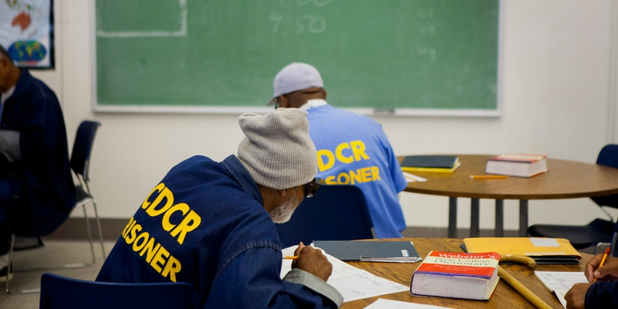 Inmates take a test as part of an educational program at the Richard J. Donovan Correctional Facility in San Diego, California, U.S., on Wednesday, March 26, 2014. California is under a federal court order to lower the population of its prisons to 137.5 percent of their designed capacity after the U.S. Supreme Court upheld a ruling that inmate health care was so bad it amounted to cruel and unusual punishment. Photographer: Sam Hodgson/Bloomberg via Getty Images
