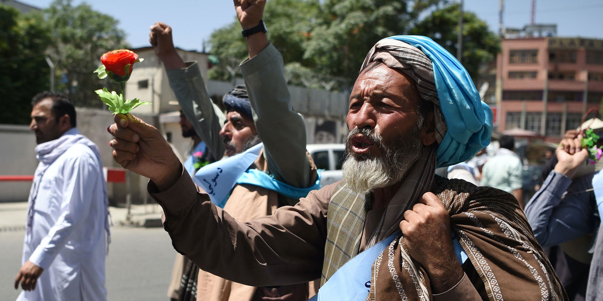 An Afghan peace activist shouts slogans in demand to an end to the war during a march from Helmand as he arrives in Kabul on June 18, 2018. - Dozens of peace protesters arrived in Kabul on June 18 after walking hundreds of kilometres across war-battered Afghanistan, as the Taliban ended an unprecedented ceasefire and resumed attacks in parts of the country. (Photo by WAKIL KOHSAR / AFP) (Photo credit should read WAKIL KOHSAR/AFP/Getty Images)