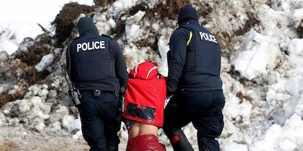 Police detain Ricardo Salazar, 25, of San Bernardino, California, in the main opposition camp against the Dakota Access oil pipeline near Cannon Ball, North Dakota, U.S., February 23, 2017. REUTERS/Terray Sylvester - RC122B1745B0