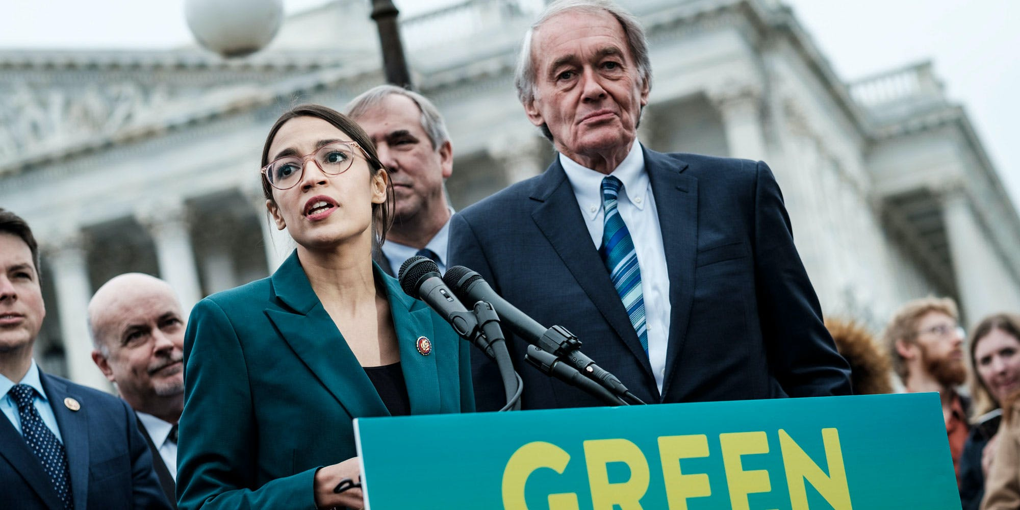 Rep. Alexandria Ocasio-Cortez (D-N.Y.) speaks alongside Sen. Ed Markey (D-Mass.) at a news conference about the Green New Deal, in Washington, Feb. 7, 2019. The measure, drafted by Ocasio-Cortez and Markey, calls for a sweeping environmental and economic mobilization that would make the United States carbon neutral by 2030. (Pete Marovich/The New York Times)