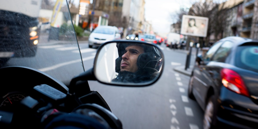 Human rights and civil liberties advocate Yasser Louati rides his scooter to a meeting on February 11, 2019 in Montreuil, France. (Pete Kiehart for The Intercept)