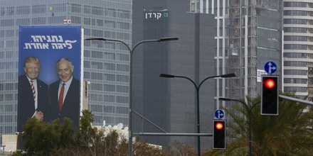 An election campaign billboard shows Israeli Prime Minister Benjamin Netanyahu, right, and US President Donald Trump in Tel Aviv, Israel, Wednesday, Feb. 6, 2019. Seeking re-election under a cloud of criminal investigations, Israeli Prime Minister Benjamin Netanyahu is channeling his inner Donald Trump in an angry campaign against his perceived domestic enemies. (AP Photo/Ariel Schalit)