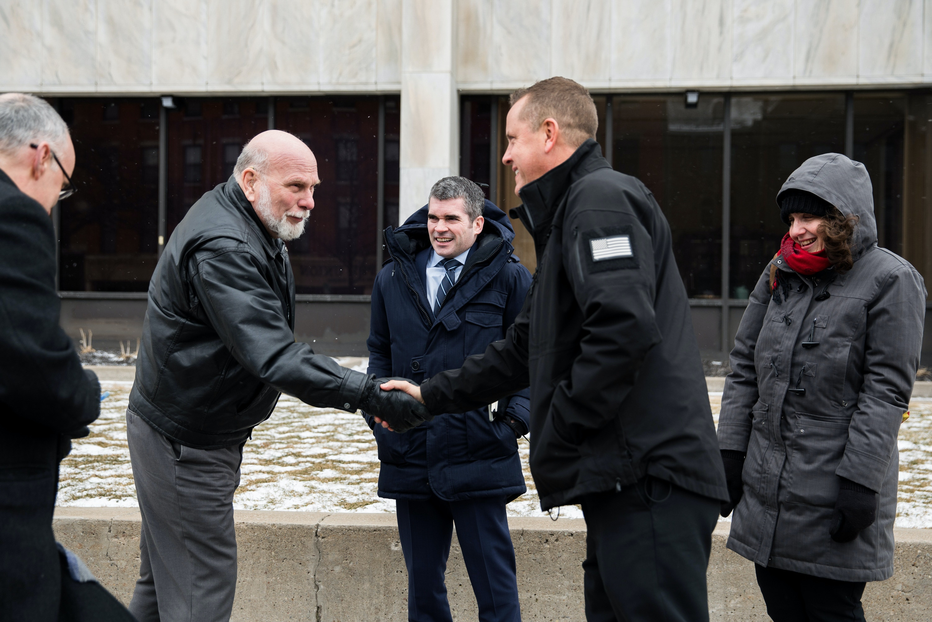 Supporter of Kimino Ngoran, Bill Genthner introduces himself to Sheriff Craig Apple at the U.S. District Court for Kimino Nigoran's hearing Monday.