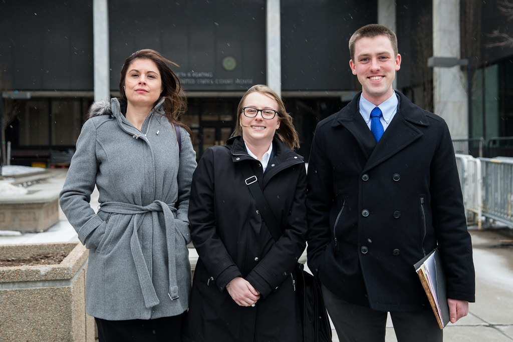 Nicole Hallett(left), Buffalo Law School professor and her students, Chloe Nowak(2nd year student) and Alexander Buszka(3rd year student) stand outside the U.S. District Court in Rochester, NY on Monday.