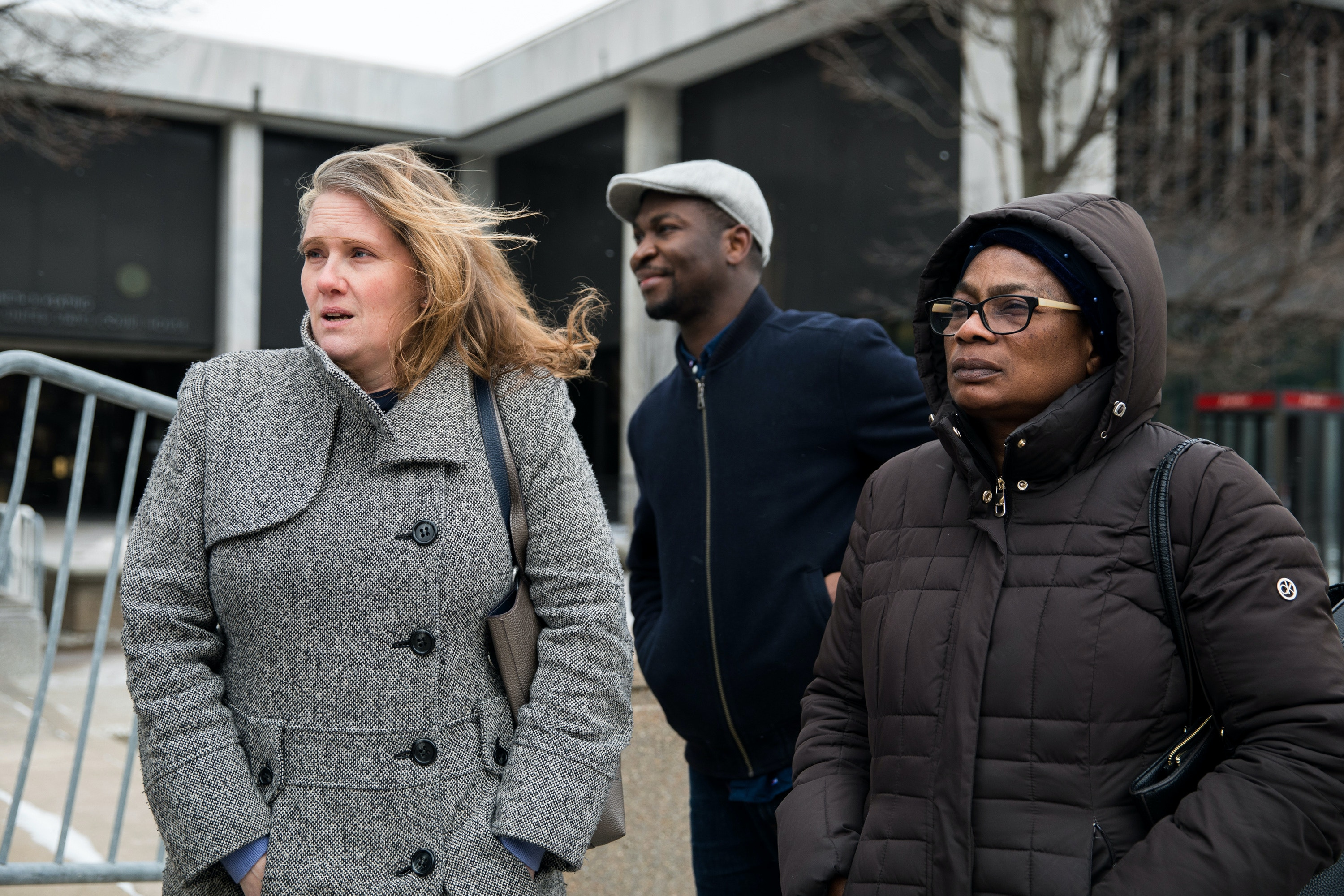 Lisa Pepper-Ngoran, Kimino's wife stands with friends and supporters, Nacouban Toure and Therese McGee outside the U.S. District Court following her husband's hearing in Rochester, NY on Monday.