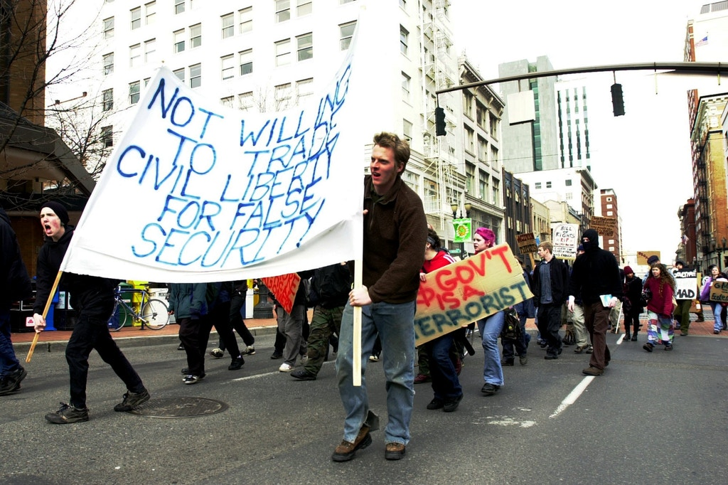 Protesters, some proclaiming to be supporters of the group Earth Liberation Front, march in Portland, Ore., Tuesday, Feb. 12, 2002. In remarks prepared for a hearing in Washington, a chairman of a House subcommittee said Tuesday that eco-terrorists are hardened criminals--that they are dangerous well-funded, savvy sophisticated and stealthy. The ELF and its sister organization the Animal Liberation Front, have claimed responsibility for 137 illegal direct actions in 2001. (AP Photo/Don Ryan)