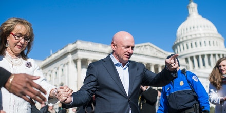 UNITED STATES - MARCH 23: Mark Kelly and his wife former Rep. Gabrielle Giffords, D-Ariz., are seen after a news conference with lawmakers at the House Triangle to call on Congress to act on gun safety legislation on March 23, 2018. (Photo By Tom Williams/CQ Roll Call) (CQ Roll Call via AP Images)