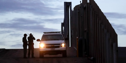 In this Wednesday, Nov. 21, 2018 file photo, United States Border Patrol agents stand by a vehicle near one of the border walls separating Tijuana, Mexico and San Diego, in San Diego. President Donald Trump's administration on Tuesday, Nov. 27, 2018, said it would appeal a judge's order barring it from enforcing a ban on asylum for any immigrants who illegally cross the U.S.-Mexico border, after the president's attack on the judge prompted an extraordinary rebuke from the nation's chief justice. (AP Photo/Gregory Bull, File)