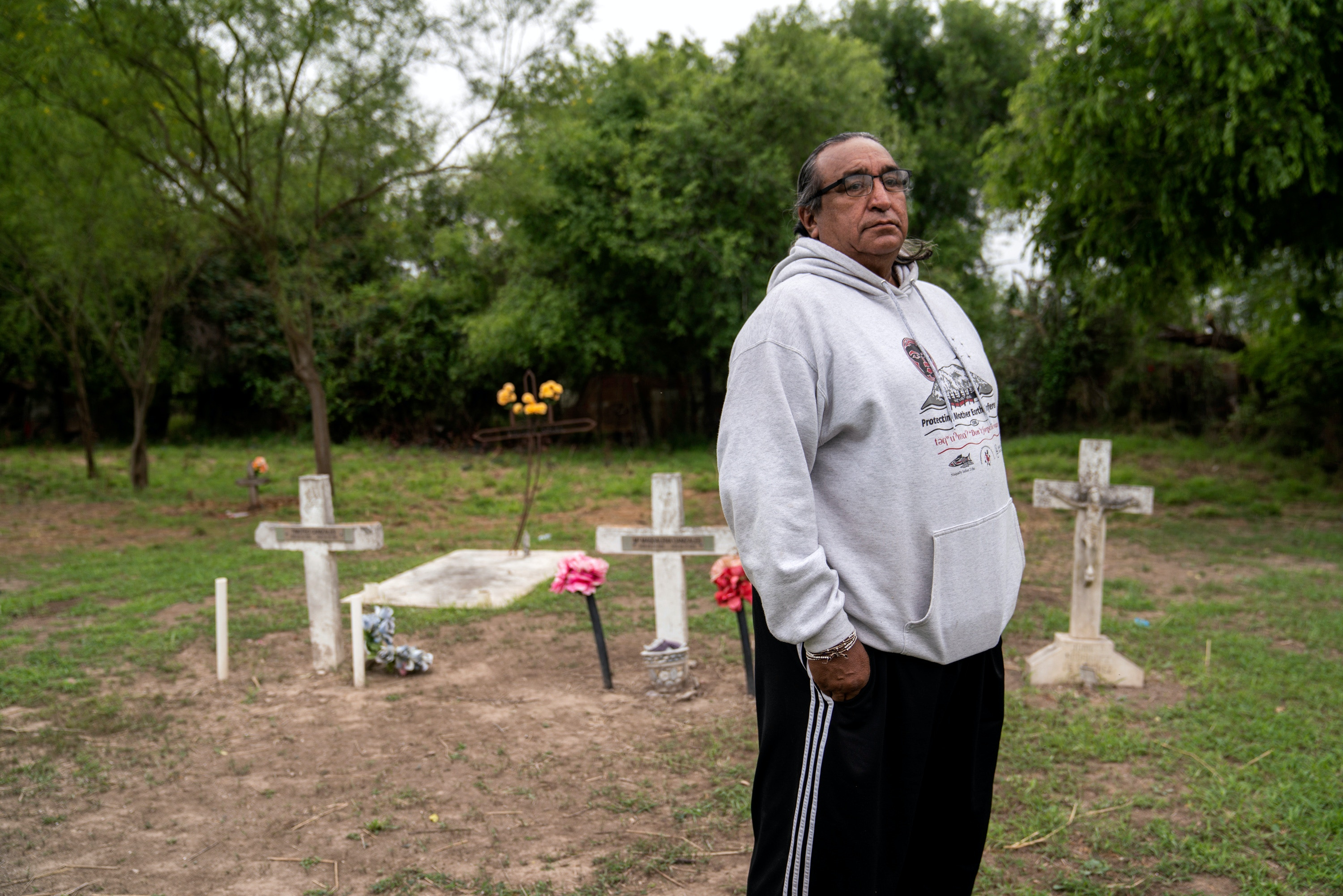 Juan B. Mancias poses for a photo at the Eli Jackson Cemetery in Hidalgo County, Texas on March 17, 2019. Photo: Verónica G. Cárdenas for The Intercept