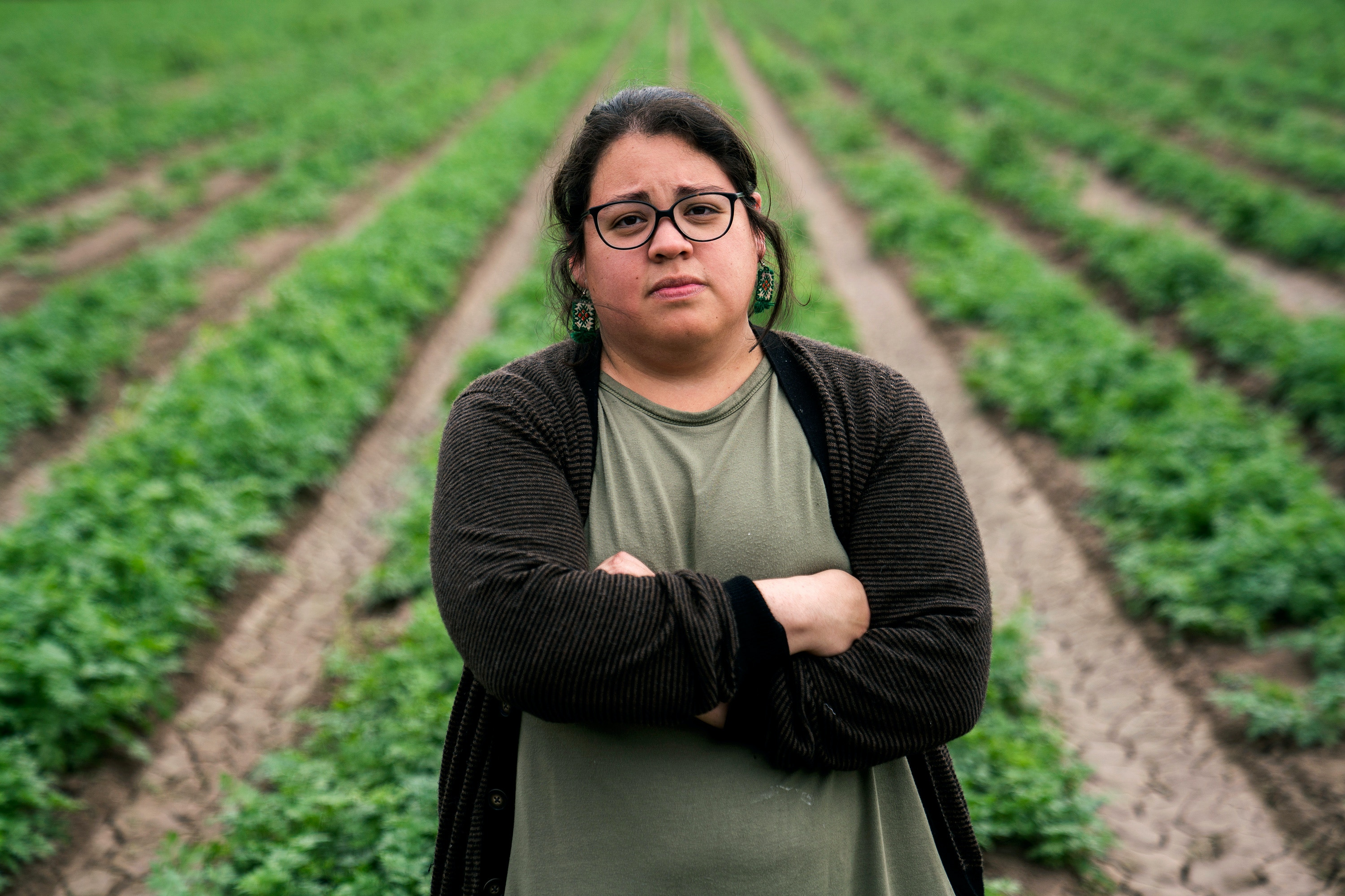 Rebekah Hinojosa, a local organizer whose ancestors are buried near already-built border barrier in Cameron County poses for a photo near Yalui Village in Hidalgo County, Texas on March 17, 2019.Photo: Verónica G. Cárdenas for The Intercept