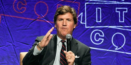 LOS ANGELES, CA - OCTOBER 21:  Fox News anchor Tucker Carlson speaks during Politicon 2018 at Los Angeles Convention Center on October 21, 2018 in Los Angeles, California.  (Photo by Michael S. Schwartz/Getty Images)
