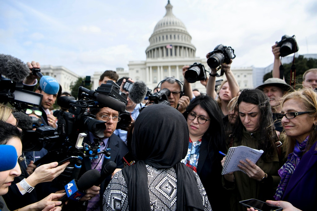 Rep. Ilhan Omar (D-MN) speaks to reporters during a youth climate rally on the west front of the US Capitol March 15, 2019 in Washington, DC. (Photo by Brendan Smialowski / AFP)        (Photo credit should read BRENDAN SMIALOWSKI/AFP/Getty Images)