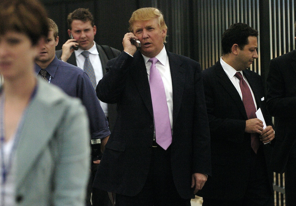 LOVELAND, CO. WEDNESDAY, SEPTEMBER 14, 2005 - Businessman Donald Trump visited Colorado to talk at the Bixpo 2005 business convention at the Budweiser Events Center. Trump walks outside the center after the speech and hit the cell phone. At Trump's left, in maroon tie, is businessman Felix Sater. ( PHOTO BY CYRUS MCCRIMMON   (Photo By Cyrus McCrimmon/The Denver Post via Getty Images)