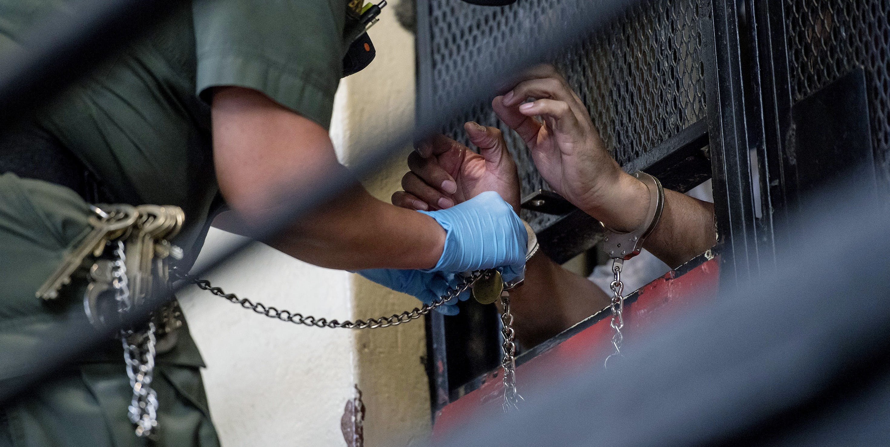A corrections officer removes handcuff from an inmate in his cell at San Quentin State Prison in San Quentin, California, U.S., on Tuesday, Aug. 16, 2016. San Quentin, home to the state's only death row, houses 725 condemned inmates. On the November 8th California ballot voters have the chance to abolish the death penalty or speed up the process. Photographer: David Paul Morris/Bloomberg via Getty Images