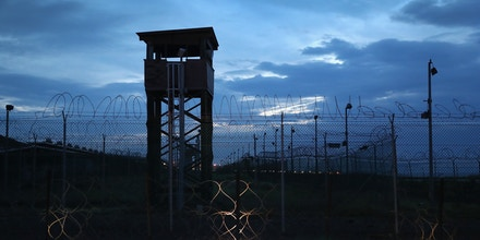 GUANTANAMO BAY, CUBA - OCTOBER 22: (EDITORS NOTE: Image has been reviewed by the U.S. Military prior to transmission.) Razor wire and a guard tower stands at a closed section of the U.S. prison at Guantanamo Bay, also known as
