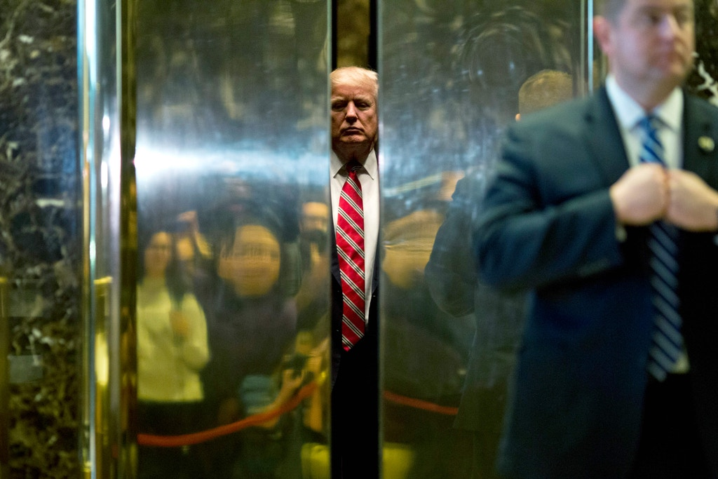 US President-elect Donald Trump boards the elevator after escorting Martin Luther King III to the lobby after meetings at Trump Tower in New York City on January 16, 2017.  / AFP PHOTO / DOMINICK REUTER        (Photo credit should read DOMINICK REUTER/AFP/Getty Images)