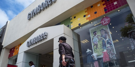 Pedestrians walk past a Gymboree Corp. store in San Francisco, California, U.S., on Thursday, May 25, 2017. Gymboree may be preparing to file for bankruptcy as it seeks to reorganize its debt load and may transfer control to its leaders as the company faces an interest payment on its debt June 1. Photographer: David Paul Morris/Bloomberg via Getty Images
