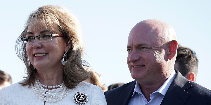 WASHINGTON, DC - MARCH 23:  Former U.S. Rep. Gabrielle Giffords (D-AZ) (L) and her husband, retired Navy combat veteran and NASA astronaut Mark Kelly (R), participate in a news conference on gun control March 23, 2018 on Capitol Hill in Washington, DC. The lawmaker, joined by students and gun control advocates, held a news conference